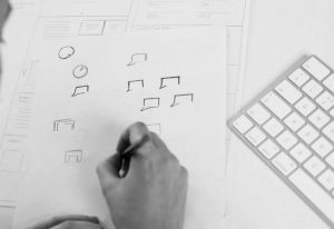 logo designer sketching logos